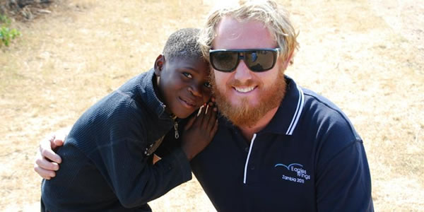 Photo of Ben with Zambian child